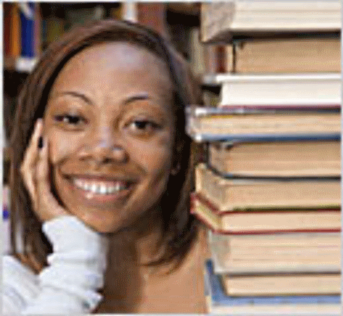 students-smilings-near-books
