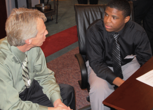 image of student talking to guidance counselor