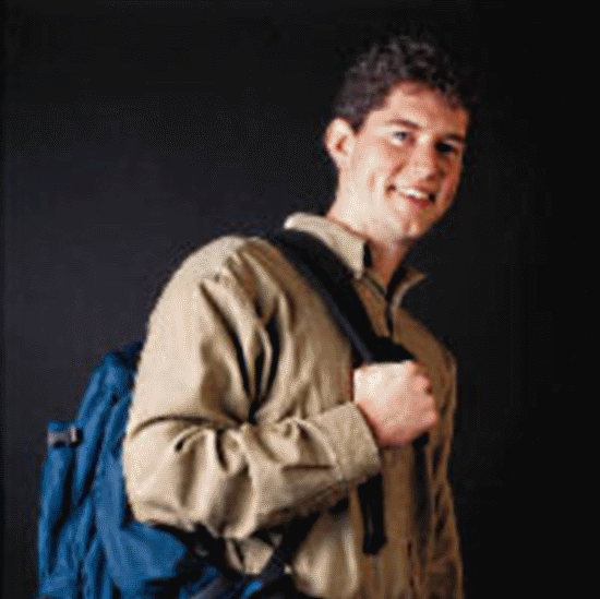 Student Standing Holding Backpack